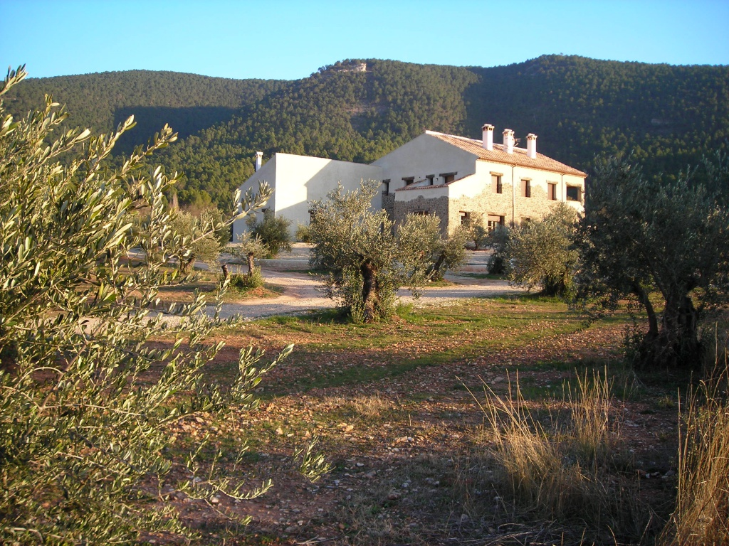 """Rural hotel """" Cortijo la Agedrea"""" located in a valley, surrounded by pine trees and mountains"""