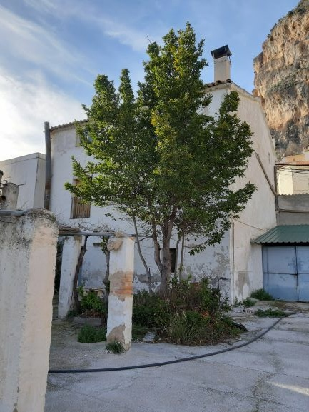 House with land for restauration